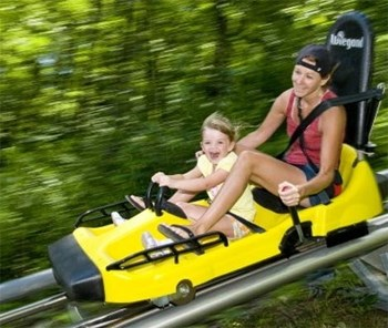 Woman and girl on Mountain Coaster at Wisp