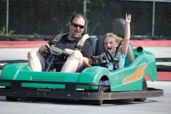 Father and son go-karting at Grand Prix Amusements