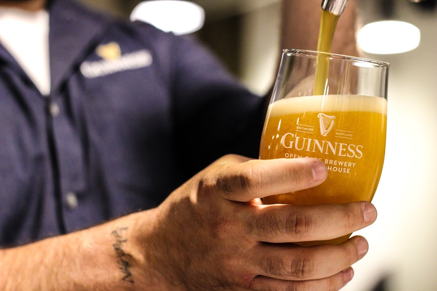 Pouring of beer at Guinness Open Gate Brewery & Barrel House