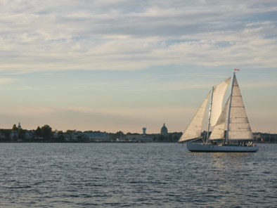 Schooner Woodwind sailing in the distance