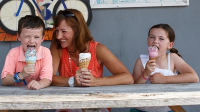 A Mother, son and daughter enjoying an ice cream cone from Scottish Highland Creamery